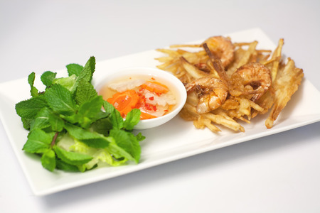 chien: Banh Tom Chien, Vietnamese deep fried shrimps and sweet potatoes fritters Stock Photo