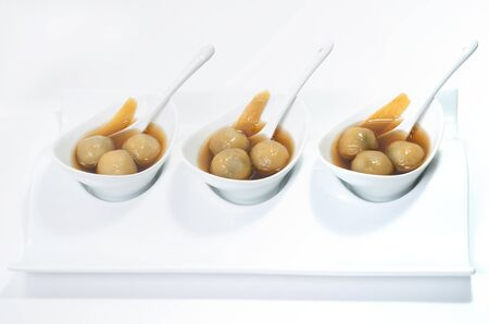 Vietnamese glutinous rice balls dessert on white background photo