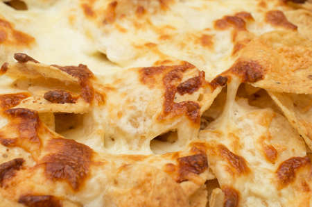 chili sauce: Tortilla chips covered with a thick layer of mozzarella cheese