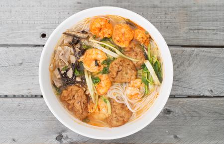 Bun Tom Hai Phong, Vietnamese shrimp and fish balls soup against wooden background