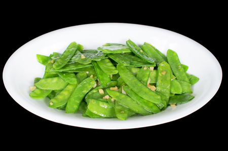 faboideae: Stir fried snow peas and minced garlic isolated black background, Vietnamese cuisine