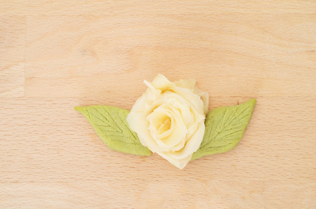 Rose made with japanese sushi ginger on wooden background photo