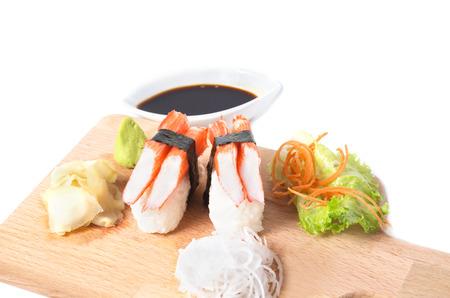 gastronome: Crab Sticks nigiri  or Kani Kamaboko sushi on wooden plate