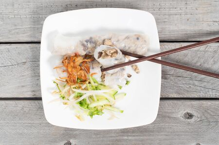 cuon: Banh cuon, Vietnamese steamed rice noodle rolls on a wooden table background