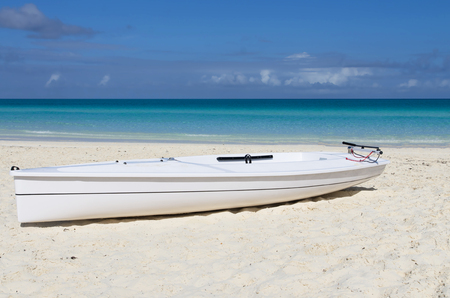 cayak: Single white kayak on white sandy beach, Cayo Santa Maria, Cuba