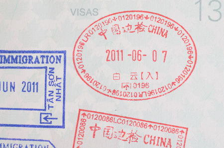 China visa passport stamp on Canadian passport close-up Stock Photo