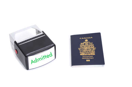admitted: Canadian passport and admitted stamp on white background