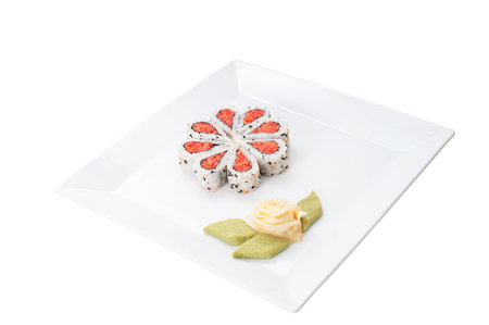 nicely: Sushi nicely decorated forming hearts  shapes on white square dish isolated on white background