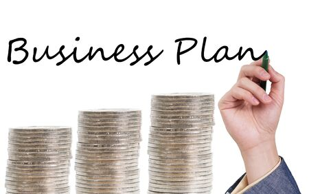 Business plan concept with three piles of coins shaping up trend Фото со стока