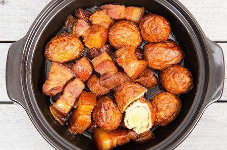 dongpo: Vietnamese caramelized pork belly with deep fried eggs  in clay pot