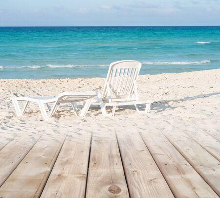 white sand beach: Wooden deck transitioning in to white sandy beach background