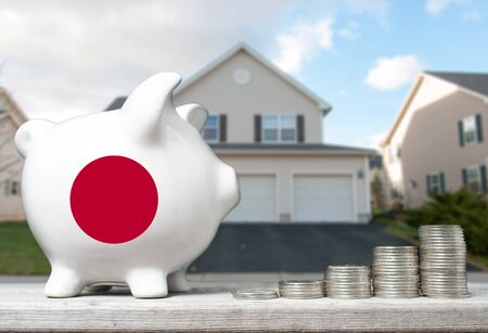 canadian coin: Japanese real estate investment concept with piggy bank, stacks of coins and house in the background Stock Photo