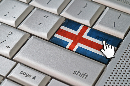 Business concept mouse cursor pressing Iceland enter key on metallic keyboard Imagens