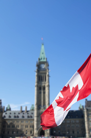 Canadian flag waving in front of the parliament Stock Photo