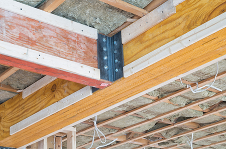 rafters: Two wooden supporting beams intersecting on ceiling of house Stock Photo