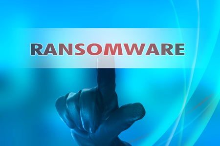 spy ware: Ransomware concept with hand wearing black glove pressing red button touch screen Stock Photo