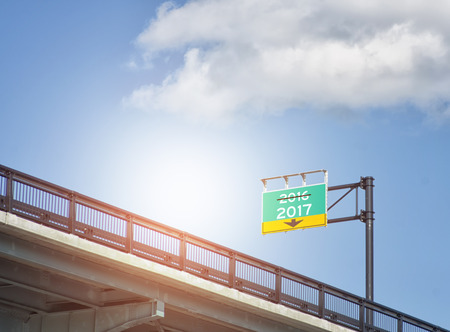 sun flare: 2017 destination concept with street sign concept on a highway exit on the bridge  with sun flare applied