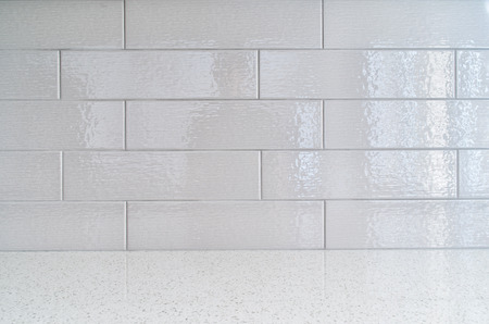 granite countertop: Modern kitchen granite countertop  against gray ceramic backsplash