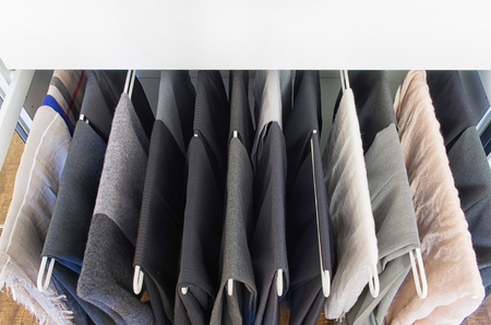 pull out: Men pants on a metal pull out rack