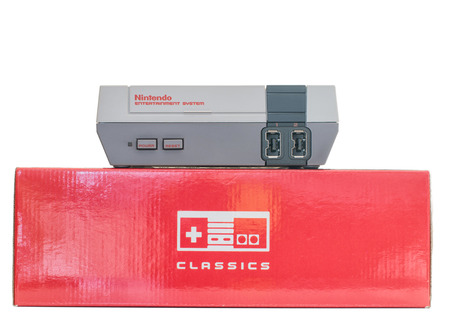 MONTREAL, QUEBEC, CANADA - JANUARY 8,2017: NES Nintendo Classic mini  edition console on top of its box. Editorial