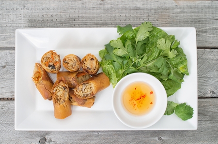 Vietnamese vegetarian egg rolls, cha gio chay on wooden background Stock Photo