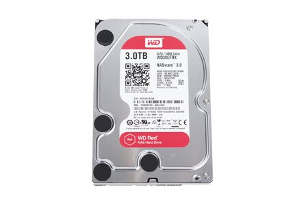 nas: MONTREAL, QUEBEC, CANADA - DECEMBER 18, 2016: Western Digital Red 3.5 inch SATA3 hard drive 3.0 TB for use in NAS systems isolated on white.
