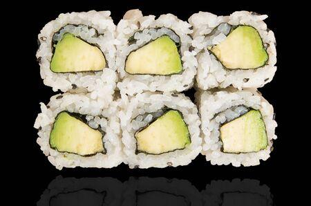 Six Japanese avocado hosomaki isolated on black background with reflection