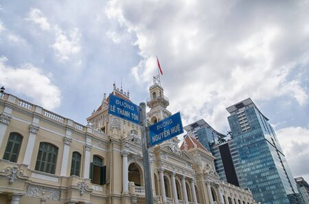 Closeup shot of two street signs in front of  Ho Chi Minh city hall, Vietnam Stock Photo