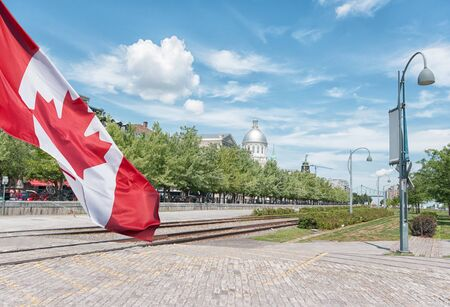 Montreal Old Port scenery during summer time  with Canadian flag waving