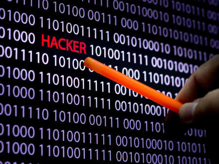 symbol victim: Computer screen shot with binary code and hacker text, great concept for technology computer and online security Stock Photo