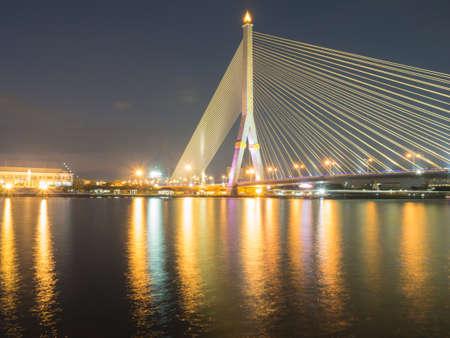 Rama VIII Bridge at night on the river in thailand Stock Photo