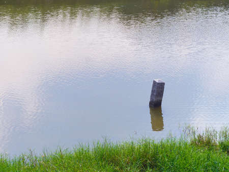 reflect: Pole reflect in the water silence concept Stock Photo