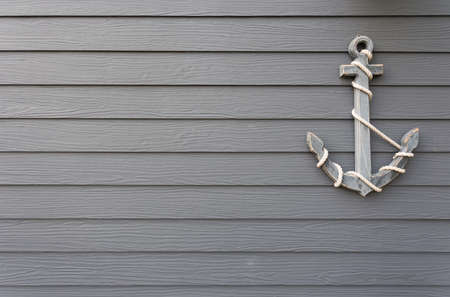 wooden anchor on wall background 스톡 콘텐츠