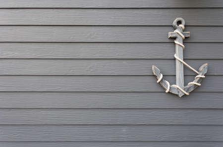 wooden anchor on wall background 版權商用圖片