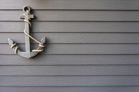 water anchor: wooden anchor on wall background Stock Photo