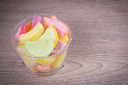 sweetmeats: jelly sweet candy on wood background Stock Photo
