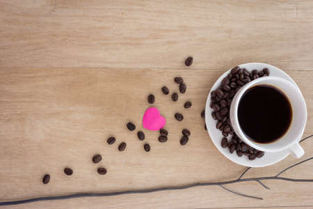 good color: cup of espresso coffee with coffee beans on wooden background