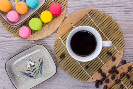 Coffee and coffee beans arranged on a wooden table, View from above with copy space Imagens