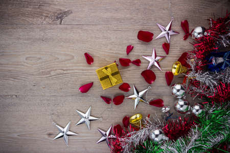 tree decorations: Christmas background with brown, star and golden bell decorations on wooden table. View from above with copy space Stock Photo