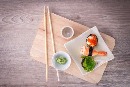 sushi chopsticks: japanese sushi set on old wood background