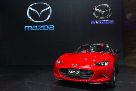 new motor vehicles: BANGKOK - DECEMBER 4 : The new red Mazda MX-5 displayed at Thailand International Motor Expo2015 MOTOR EXPO 2015 exhibition of vehicles for sale on December 4, 2015 in Bangkok, Thailand.