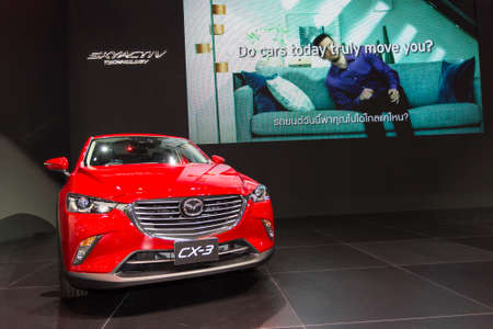 mazda: BANGKOK - DECEMBER 4 : The new red Mazda CX-3 displayed at Thailand International Motor Expo2015 MOTOR EXPO 2015 exhibition of vehicles for sale on December 4, 2015 in Bangkok, Thailand.