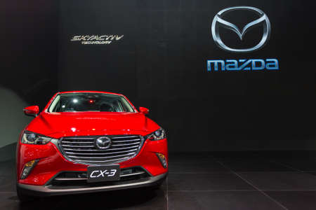 new motor vehicles: BANGKOK - DECEMBER 4 : The new red Mazda CX-3 displayed at Thailand International Motor Expo2015 (MOTOR EXPO 2015) exhibition of vehicles for sale on December 4, 2015 in Bangkok, Thailand.