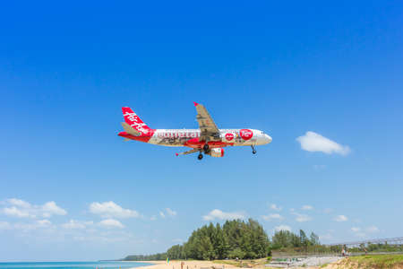 16: Phuket,Thailand - February 16, 2016: Airasia landing at Phuket international airport on February 16, 2016. The plane comes in Phuket international airport.