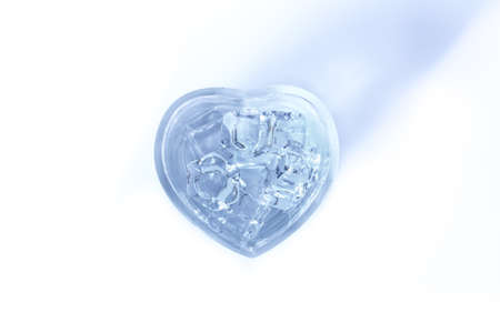 glass heart: Water in glass heart on a white background Stock Photo