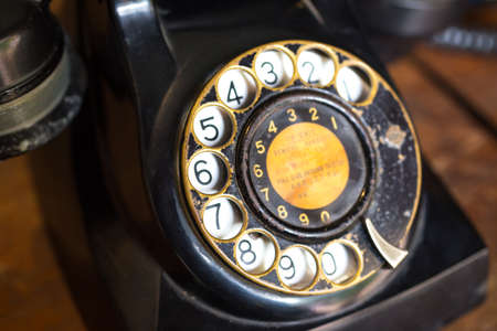 black vintage telephone on table Stock Photo