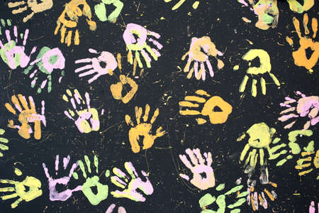 Colorful hand painting on black background.