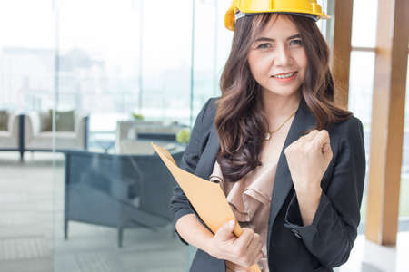 Beautiful Asia business woman over blured office background. 스톡 콘텐츠