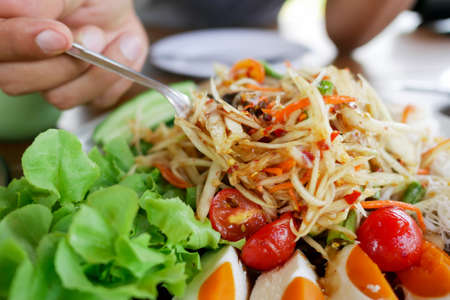 Papaya salad is a food that is popular among Thai people. Close up of Thai food style.