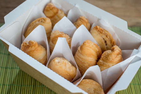 Set of curry puff in paper box.